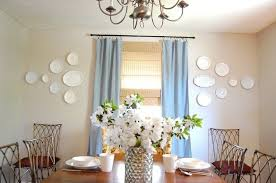 dining room wall decorating ideas: plain white plate wall decor for a dining room