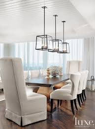 in this stunning dining room three holly hunt light fixtures are suspended over a rectangular breakfast table lighting
