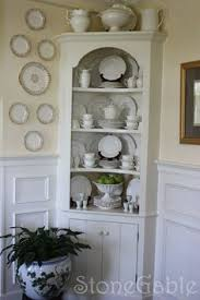 corner cabinets dining room: with each season holiday or just on a whim this slender built in cupboard in my dinning room gets a facelift i love choosing plates and accent pieces to
