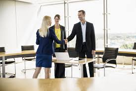 when and how to say goodbye to your real estate agent couple shaking hands w in office