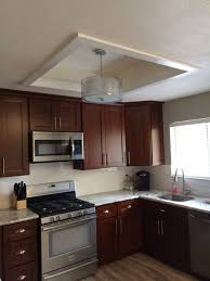 kitchen linear dazzling lights clear ceiling recessed: fluorescent kitchen ceiling lights above single bowl stainless steel sink undermount and  burner gas stove with electric oven also wooden knife block set