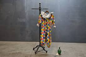 Image result for clown costume on a rack