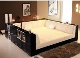 living room with bed: couch bed how cool is that for our future quottheatre roomquot for