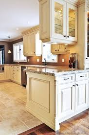 traditional antique white kitchen cabinets brown wall color cabinet color and under counter lighting floor cabinet and lighting