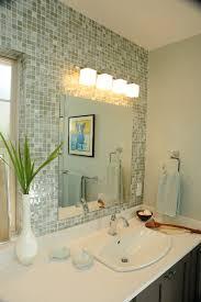 placement of light above mirror bathroom lighting lighting mirrors