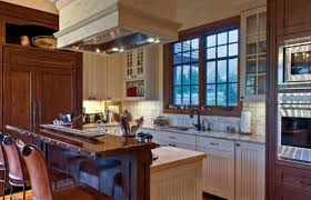kitchen fashioned rustic the beaded board cabinet fronts and warm wood tones give this kitchen