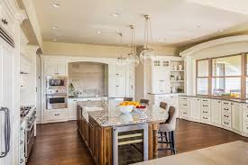 beautiful white kitchen cabinets: contemporary white kitchen with large dining island