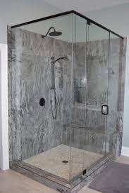 bathroom features gray shaker vanity: master bathroom with grey shaker vanity porcelain tile pebble shower floor oil rubbed bronze fixtures freestanding soaker tub and shutter windo