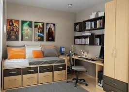 teens room wooden gray cabinets book case table shelves chair mattres orange whute pillow bed room carpet fur rug frame picture floor down light teen boy chairs teen room adorable rail bedroom