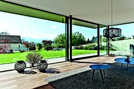 large sliding patio doors:  sliding patio doors help bring the garden into this cool swiss home