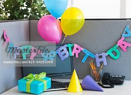close up of birthday decorations on office desk stock photos masterfile birthday office decorations