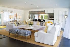 living room with white couch and yellow accents beach house living room tropical family room