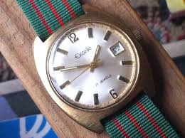 sweep second hand vintage men s watch elgin excelle watch 17 jewel date window sweep second hand circa mid 1970s lion head band delovelyness on