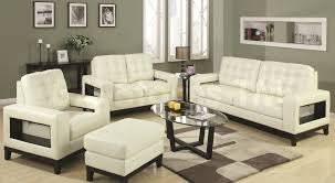 cream couch living room ideas: contemporary tufted leather cream sofa set with single cream puff and round glass coffee table in
