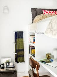 logan square condo lofted bedroom example of a small trendy loft style bedroom design in chicago bed with office underneath