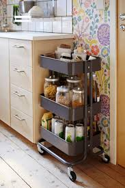 kitchen floor tiles small space: portable spice rack with wheels beside cabinet for tiny kitchen spaces with hardwood floor tiles