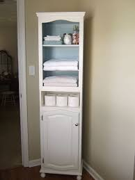 hometalk linen cabinet storage solution from 2 thrift store cabinets to one tall bathroom bathroom furniture ideas