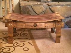this bench is made from a repurposed wine barrel alpine wine design outdoor