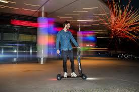 Audi combines <b>e</b>-<b>scooter with</b> skateboard | Audi MediaCenter