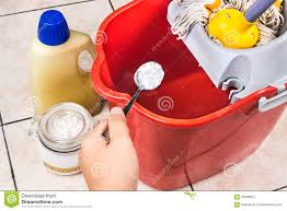 add baking soda to floor cleaner for house cleaning stock photo add baking soda to floor cleaner for house cleaning