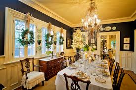 fabulous dining room with interesting tile window decor facing dining room chandeliers above long table