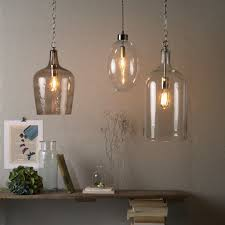 glass bottle lighting contemporary clear glass bottle pendant lamps feature iron chain clear glass shade pendant aussenansicht der red bull zentrale