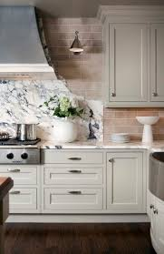 subway tiles tile site largest selection: glass tile backsplash gorgeous kitchen with ivory shaker kitchen cabinets cabinet moldings marble countertops and cooktop backsplash glass tiles