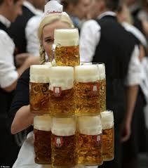 oktoberfest 2014 it takes serious skills to be a waitress at oktoberfest as this w shows by holding