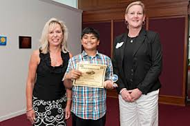delaware students produce winning stock portfoliosabhishek damarauiu  first place winner of the investwrite essay competition in the grades   category    principal andrea lanciault  left