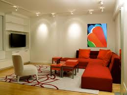 living room lighting design with ceiling track lighting with head lamps over red sectional sofa ceiling track lighting systems