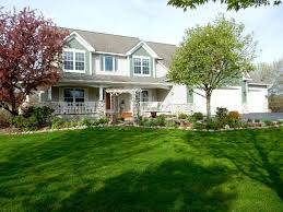 moonlight drive shakopee mn mls edina realty executive home that has amazing trees and plants throughout the property