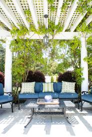 iron trellis patio traditional blue shutters  images about patio makeover on pinterest outdoor sectionals decks and
