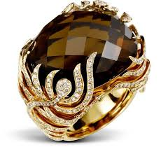 BURNING MOCHA Flames of diamonds embrace the 38 carat ...
