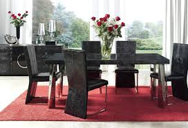 elegant square black mahogany dining table: small black rug under oval glass top dining table combined with black leather arm