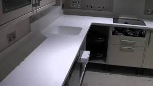 corian kitchen top: staron kitchen worktop in colour sanded cream by prestige work surfaces corian solid surface