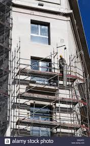 scaffolding scaffolder builder erecting scaffold spanish workman scaffolding scaffolder builder erecting scaffold spanish workman building in madrid spain