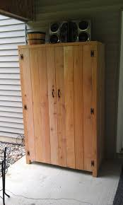 Small Wood Cabinet With Doors Fantastic Outdoor Cedar Storage Cabinet With Black Butterfly