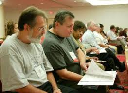 David Dutschke and Steve Bogus of Louisville, Ky., look over reports at the Catholic Charities legislative hearing. -- Larry Peplin - p09ph