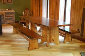 walnut cherry dining: cherry dining table and benches with live edge