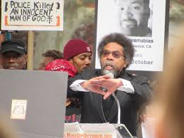 the knockout striking oppression one post at a time cephus johnson uncle of oscar grant stands next to cornel west during the