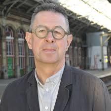 Caption: UCLan journalism lecturer Michael Williams on Preston railway station. Photo credit: Laura Kureczko. Preston's war effort has been praised in a new ... - michael_williams_rdax_500x500