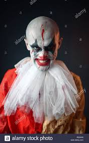 Portrait of mad bloody clown, face in <b>blood</b>. <b>Man</b> with makeup in ...
