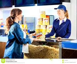 worker eating popcorn at cinema concession stand stock photo cover letter worker eating popcorn at cinema concession stand stock photo pregnant w buying mid adult