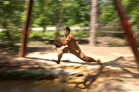 u s department of defense photo essay a paratrooper negotiates a water obstacle as part of the regiment s spur ride a rite