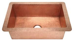 hammered copper kitchen sink: copper kitchen sink pebbled hammered copper design pictured here