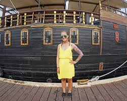 cartagena a photo essay have curiosity will travel yellow dress black boat