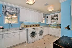 washer dryer cabinet laundry room contemporary with wood cabinets white cabinets beach style laundry room
