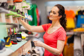young female sportswear shop assistant working in store stock stock photo young female sportswear shop assistant working in store