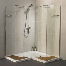 bathroom ideas corner shower design: charming v shaped glass shower stall kits with silver faucet on ivory tile wall for bathroom