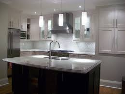 gray kitchen cabinets with black counter brown dark gray